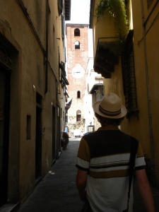 A very narrow street with tall buildings in the Italian town of Lucca. In this case, good ratios equal high charm.