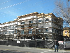 An apartment building under construction in a residential Provo neighborhood.